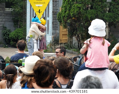 Verdun Quebec Canada - 30 August 2015 Community neighbourhood children theatre, family outdoors summer entertainment along city street ,  pedestrian fun fair  downtown party.
