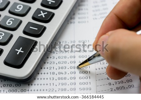 Verify the monthly bank statement - stock photo