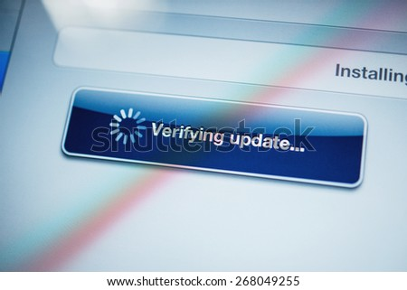 Verifying update text message on digital tablet screen - tilt-shift lens used to depict the technology background - stock photo