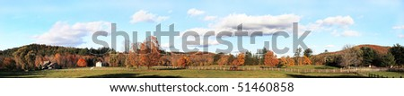 Vermont peaceful panoramic view of fall foliage farm with cows and horse on background - stock photo