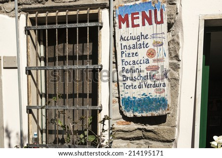 VERNAZZA, ITALY - APRIL 26; Menu sign,outside a rustic restaurant promoting an  Italian.menu on April 26, 2011 in Vernazza, Italy. Vernazza, a Cinque Terre village, a very popular tourist destination - stock photo