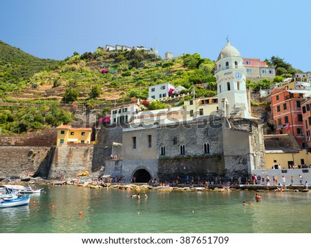 VERNAZZA, ITALY - CIRCA JULY 2015: The little harbour of Vernazza in the Cinque Terre is full of tourist walking along the dock on July 2015 in Vernazza, Laguria, Cinque Terre, Italy. - stock photo