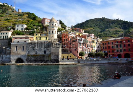 VERNAZZA, ITALY - NOVEMBER 8: View on central square of Vernazza, its colorful buildings and on famous old church of Santa Margherita d'Antiochia, Cinque Terre, Italiy. Vernazza, Italy - Nov 8, 2014 - stock photo