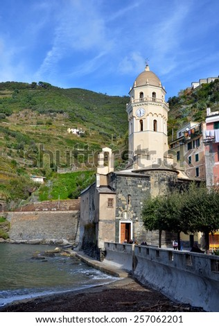 VERNAZZA, ITALY - NOVEMBER 8: View on central square of Vernazza, its colorful buildings and on famous old church of Santa Margherita d'Antiochia, Cinque Terre, Italiy. Vernazza, Italy - Nov 8, 2014