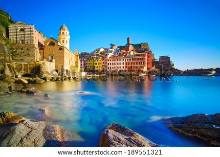 Vernazza village, curch, rocks and sea harbor on sunset, Seascape in Five lands, Cinque Terre National Park, Liguria Italy Europe. Long Exposure. - stock photo