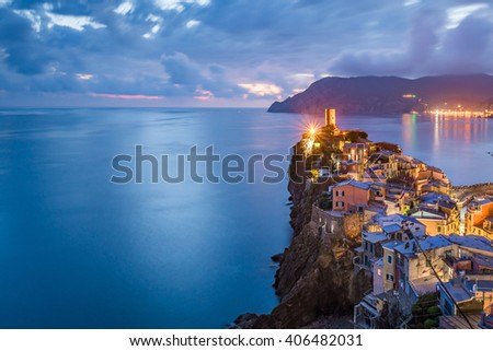 Vernazza village, Ocean Rugged Coast Harbour Aerial View Panorama Scenic Postcard view under Dramatic Sky Blur Cloud at night in Summer. Cinque Terre National Park, Liguria Italy - stock photo