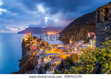 Vernazza village, Ocean Rugged Coast Harbour, Castello Doria Aerial View Panorama Scenic Postcard view under Dramatic Sky Blur Cloud at night in Summer. Cinque Terre National Park, Liguria Italy - stock photo