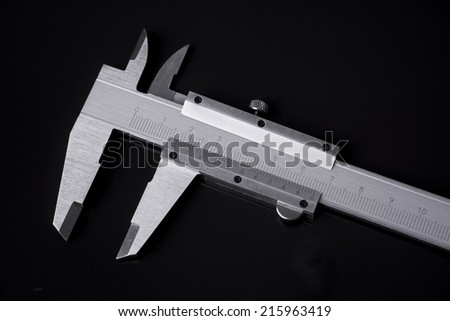 Vernier-caliper isolated on black - stock photo