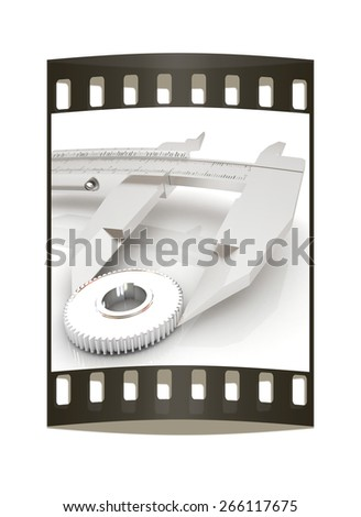 Vernier caliper measures the cogwheel on a white background. The film strip - stock photo