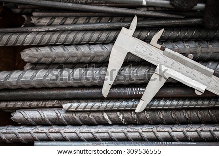 Vernier Caliper, precision measurement tool put on steel - stock photo