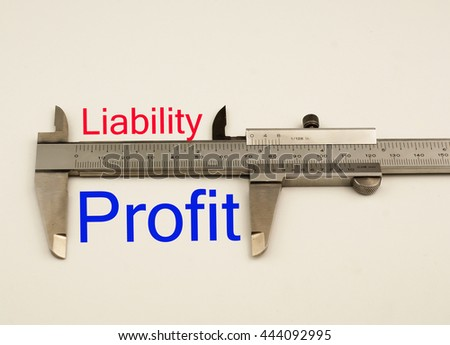 Vernier caliper with word liability vs profit .Antonym concept - stock photo