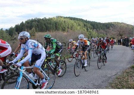 VERNON, FRANCE - MAR 01: Kevin Reza, Europcar, in peloton pack riding La Classic Sud Ardeche UCI Europe Tour Pro Race on March 01, 2014 in Versas Hill, Ardeche, France. Florian Vachon won the race. - stock photo