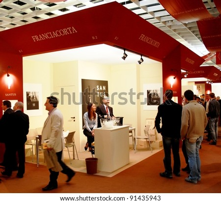 VERONA - APRIL 08: People visit tasting areas through the wine production stands at Vinitaly, international wine and spirits exhibition April 08, 2010 in Verona, Italy.