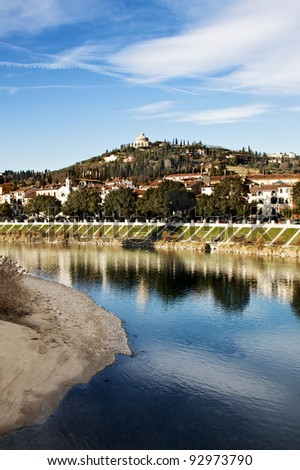 Verona - Italy, 'Adige' River and 'Madonna of Lourdes' Shrine on the top of the Hill - stock photo