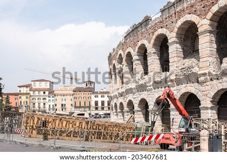 VERONA, ITALY - APRIL 23: The arena of Verona, Italy - April 23, 2014. The amphitheatre could host more than 30,000 spectators in ancient times. Foto taken from Piazza Bra.