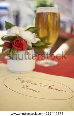 VERONA, ITALY - JULY 11: Close up of paper table cover of traditional Caffe al Teatro restaurant. July 11, 2015 in Verona. - stock photo