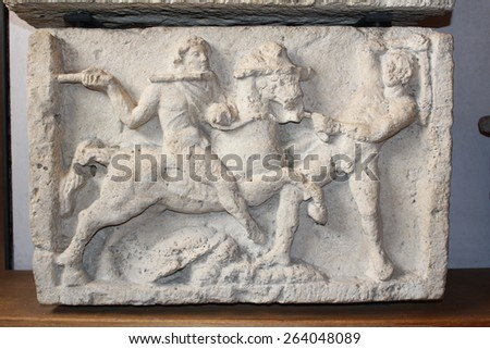 VERONA, ITALY - MARCH 18: An Etruscan cinerary urn bottom in Museo Lapidario Maffeiano at Piazza Bra on March 18, 2015 in Verona. A battle scene is depicted, in 2nd century B.C. From Perugia. - stock photo