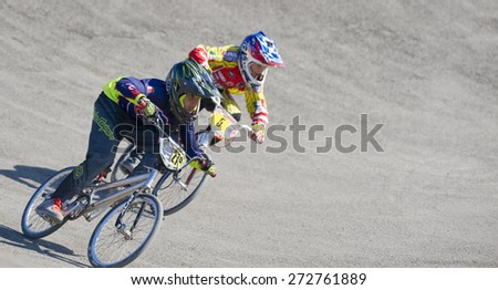 "VERONA, ITALY - MARCH 28: Unidentified child BMX rider on March 28, 2015 in Verona, Italy. This competition included young riders from many European countries at the ""BMX Olympic Arena"" in Verona."