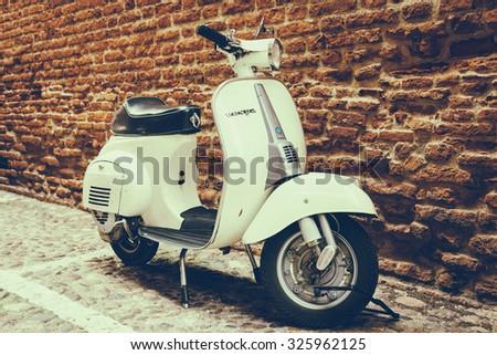 VERONA, ITALY - MAY 16, 2014: Old Vespa parked on old street in Verona, Italy - stock photo