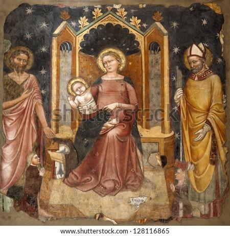 VERONA - JANUARY 28: Fresco of Holy Mary with st. John the Baptist and st. Zeno from 14. cent. in church Santa Maria della Scala in on January 28, 2013 in Verona, Italy. - stock photo