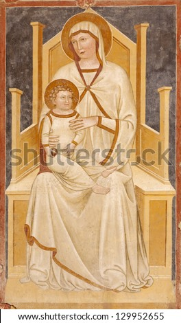 VERONA - JANUARY 27: Fresco of Madonna with the child from 13. - 14. cent. in basilica San Zeno in January 27, 2013 in Verona, Italy. - stock photo