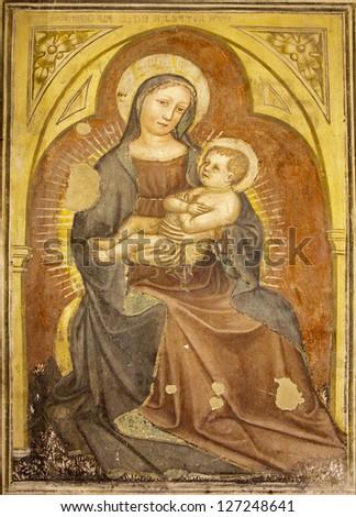 VERONA - JANUARY 27: Madonna fresco from 12. - 15. cent. by anonym author in Basilica di San Zeno on January 27, 2013 in Verona, Italy. - stock photo