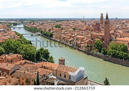 Verona skyline with Adige river at noon. Sant' Anastasia Church and Torre dei Lamberti (Lamberti Tower) also visible. - stock photo