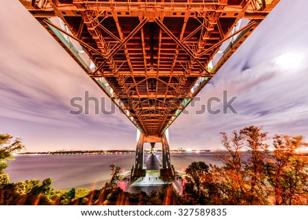 Verrazano Bridge underpass as seen from Staten Island leading into Brooklyn, New York at night. - stock photo