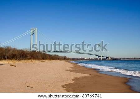 Verrazano Bridge with clean beach against a nice blue clear sky. Extra space for words at top of image
