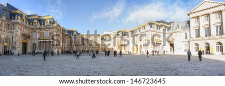 VERSAILLE, FRANCE - DECEMBER 30, 2012: Tourists visit the famous Versailles Palace on December 30, 2012 in Versaille, France