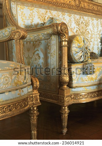 Versailles, France - 13 August 2014 : Detail of fabric armchairs at Versailles Palace ( Chateau de Versailles ). It was added to the UNESCO list of World Heritage Sites. - stock photo