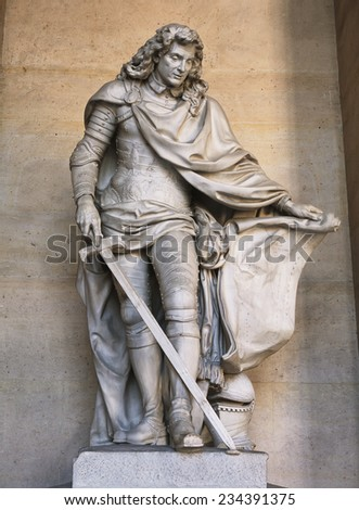 Versailles, France - 10 August 2014 : King's marble statue at Versailles Palace ( Chateau de Versailles ). It was added to the UNESCO list of World Heritage Sites.