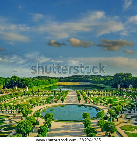 VERSAILLES, FRANCE - AUGUST 1: The Royal Palace and the gardens of Versailles on August 1, 2010. The palace and surrounding gardens is are on the UNESCO World Heritage List - stock photo