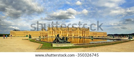 VERSAILLES, FRANCE - AUGUST 1: The Royal Palace in Versailles on August 1, 2010. The palace and surrounding gardens is are on the UNESCO World Heritage List - stock photo