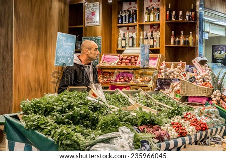 VERSAILLES, FRANCE - NOVEMBER 13, 2014: Large selection of meat and seafood, cheeses, sweets, fruit and vegetable represented famous Notre-Dame market since time of Louis XIV (built in 1841).