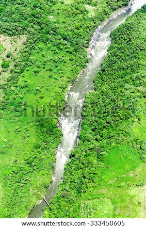 Vertical Aerial Shot Of A High Water Volume River From High Altitude - stock photo