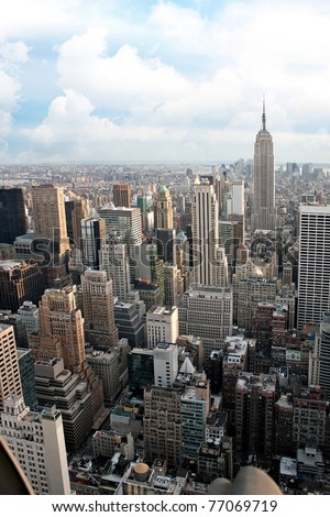 Vertical aerial view of the Manhattan section of New York City including all of the buildings and skyline. - stock photo