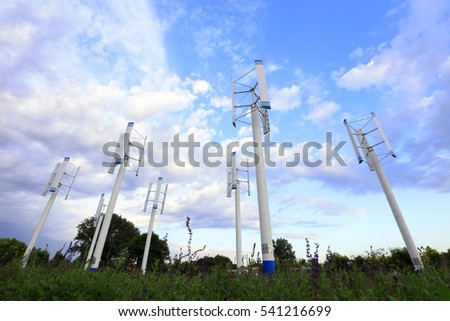 vertical axis wind turbine under blue sky