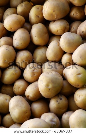 Vertical background image of biological potatoes in a market
