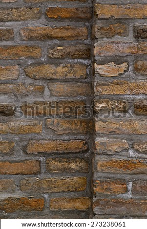 Vertical background pattern of weathered old brick wall texture, grungy rusty brushed blocks as urban architecture backdrop. - stock photo
