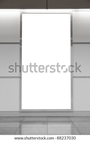 Vertical blank billboard on a bright wall with reflection on a floor - stock photo