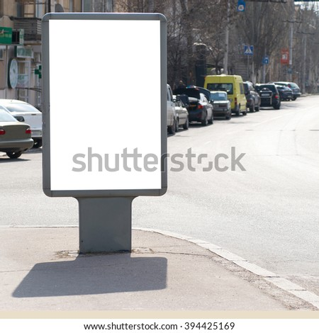 Vertical blank billboard on the city street
