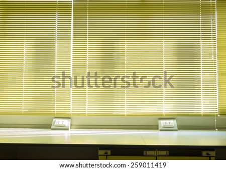 vertical blind in use to block sun light - stock photo