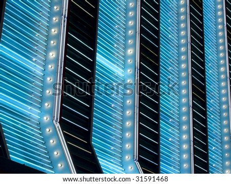 vertical blue and white neon marquee lights - stock photo