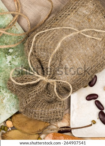 vertical bright collage of ceramic tiles in country style in different shades, tree bark, twine and legumes on natural fabric - stock photo