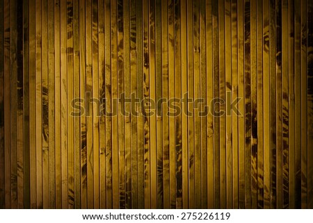 Vertical brown mat of bamboo stalks covered with spots - stock photo