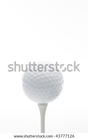 Vertical close up of a golf ball on a tee - stock photo