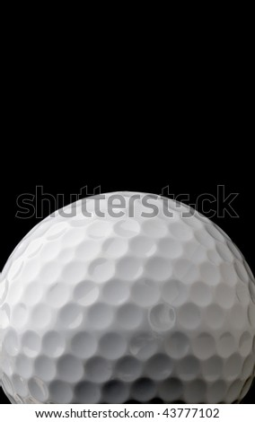vertical close up of a white golf ball on black