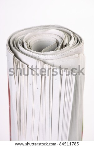 Vertical close up view of rolled newspaper on white background for copy space - stock photo