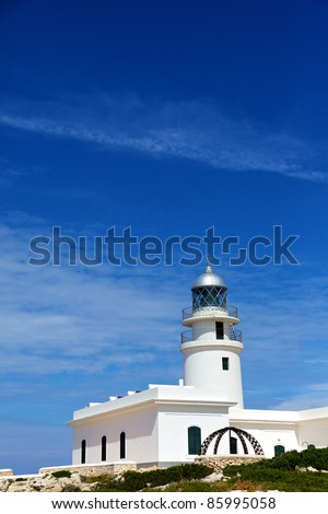 Vertical color image of a white lighthouse in a hot summer's day. - stock photo